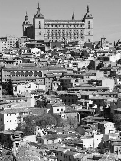 Alcazar With Townscape Against Sky