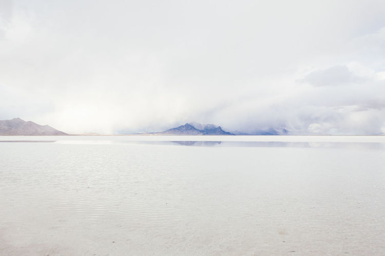 Salt Flats Calm Coastline Distant FootPrint Great Salt Lake Horizon Horizon Over Water Moutain Outdoors Plateau Salt Flat Salt Flats Scenics Sea Shore Tranquil Scene Utah Vacations Weather Landscapes With WhiteWall The KIOMI Collection The Great Outdoors - 2016 EyeEm Awards