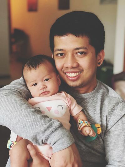Portrait of man carrying cute girl