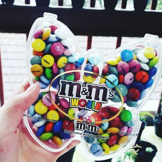 M&m Multi Colored Candy Sweet Food Food Temptation Indulgence Unhealthy Eating Ice Cream Frozen Food People Close-up One Person Outdoors Human Hand Ready-to-eat Human Body Part Day