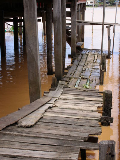 Wooden jetty on pier at lake