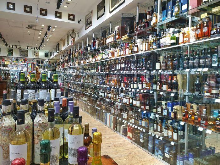 Panoramic shot of bottles in display at store