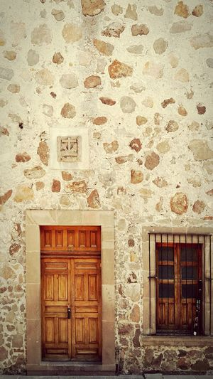 Mexican door, San Luis Potosí. Ancient Architecture Mexican Architectural Feature Wall Traditional Door Window Textured  Architecture Traditonal Colonial Architecture Colonial Style Mexican Style Houses And Windows House And Door