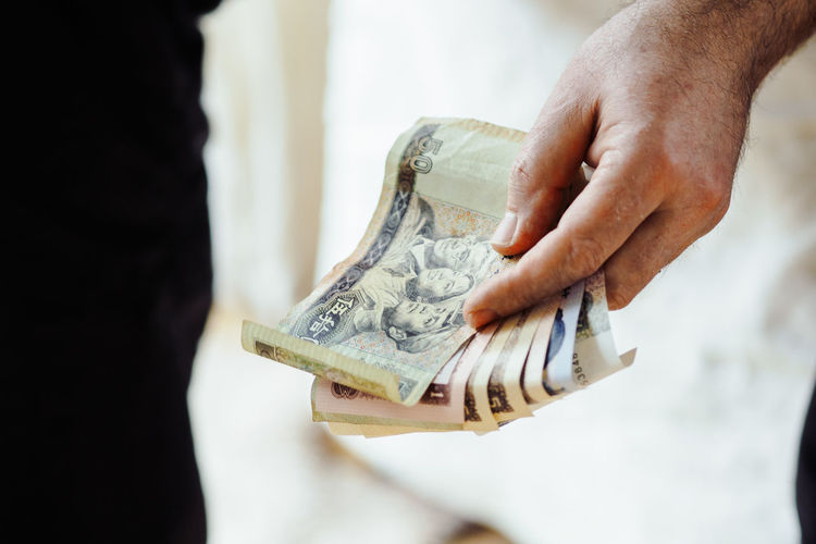 Banking Business Buying Close-up Currency Day Finance Giving Holding Human Body Part Human Hand Indoors  Midsection Money Paper Currency People Savings Two People Wallet Wealth