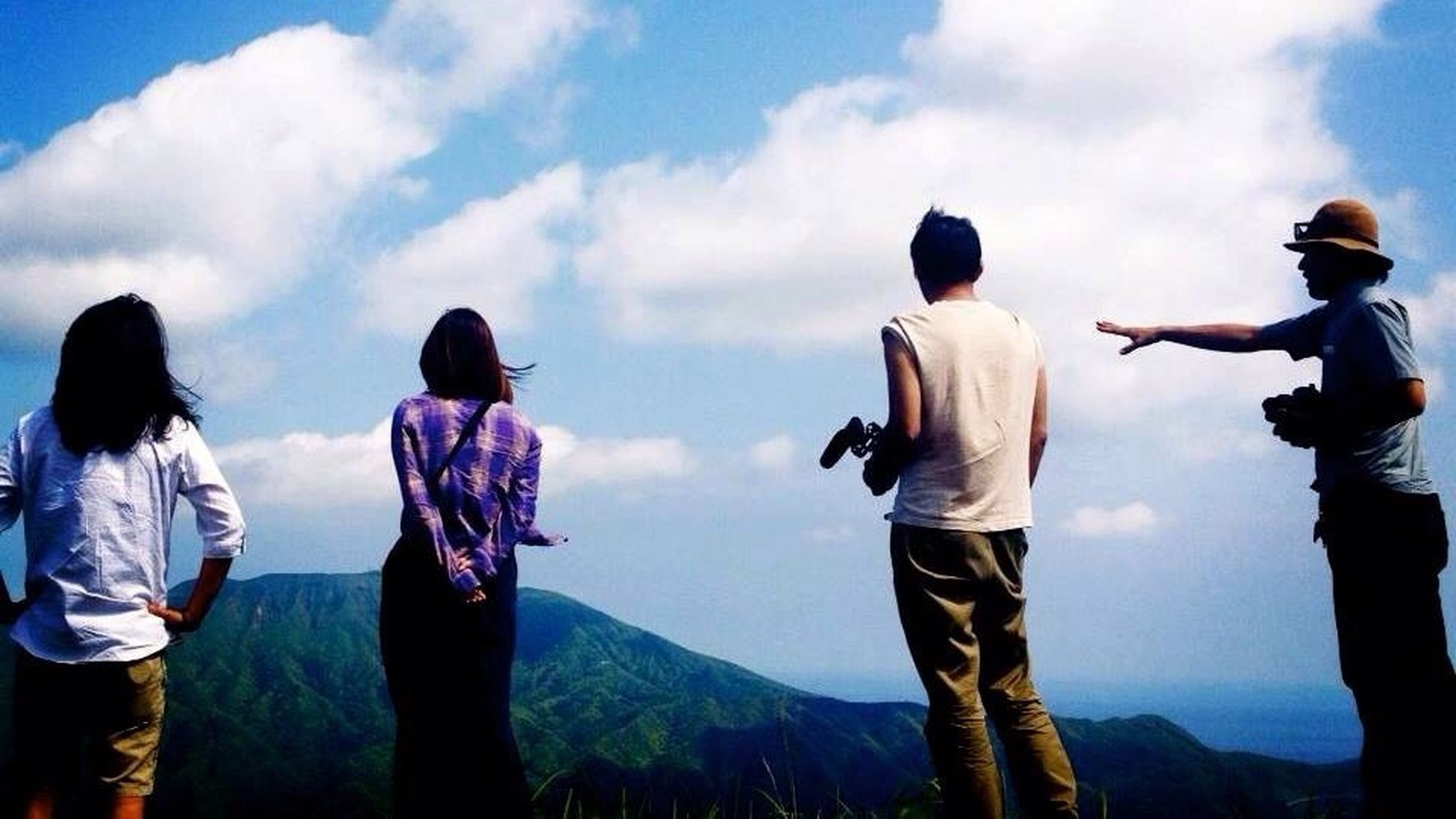 lifestyles, leisure activity, sky, men, mountain, rear view, standing, togetherness, casual clothing, cloud - sky, full length, person, bonding, nature, cloud, three quarter length