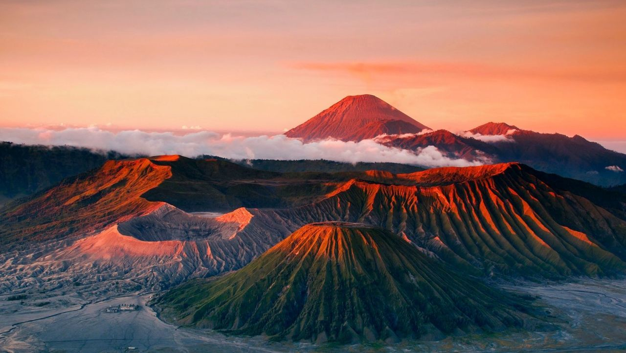 VIEW OF VOLCANIC LANDSCAPE AGAINST SUNSET SKY