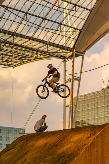 Bike and Style, Airport Munich jump competition Bike And Style, High Jump Competition Jump Velo Action Sports Airport Munich Bicycle Rack Competition Extreme Sports High Angle View Jump Ramp Loop Sky Style Xgames