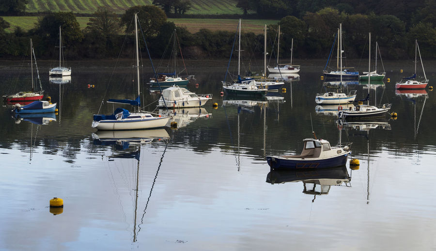 boats moored on the Fal Cornwall Boat Mast Mode Of Transport Moored Nautical Vessel Reflection Water Water Reflections