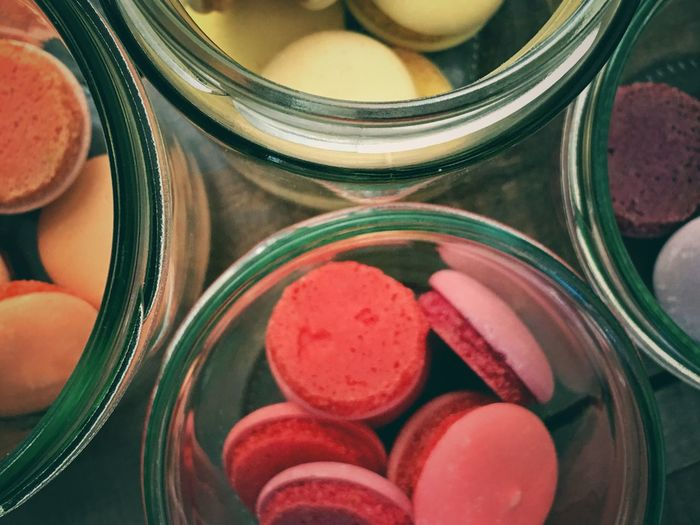 High Angle View Of Cookies In Jars Jar Red No People Close-up Multi Colored Food Unhealthy Eating Freshness Indoors  Day Cookie Studio Shot Photography Color Image Horizontal Ready-to-eat Indulgence Macaron Food And Drink Sweet Food Glass High Angle View Directly Above Selective Focus