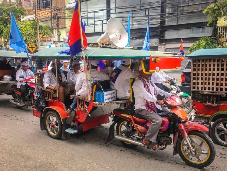 PHNOM PENH, CAMBODIA - 2017 MAY 28 - Unidentified supporters of the Cambodian National Rescue Party (Opposition) marching in the street in the capital, Phnom Penh.