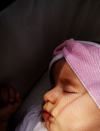 High angle view of baby girl sleeping