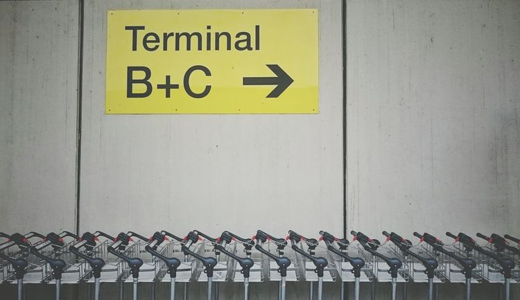 Let's go Starting A Trip Airport Traveling Travel Journey Sign Terminal Luggage Luggage Trolleys Trolley Tegel Tegel Airport Berlin Concrete Concrete Wall Yellow Outdoors No People Streetphotography Travel Photography Let's Go. Together.