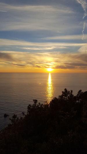 Liguria Bonassola Sunset Sea Horizon Over Water Nature Water Scenics Beach Beauty In Nature Cloud - Sky Sky Reflection Dramatic Sky Sun Tranquility Silhouette Tranquil Scene Outdoors No People Sunlight Travel Destinations