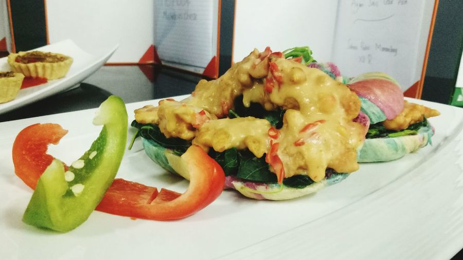 rainbow bagel with chicken salted egg sauce