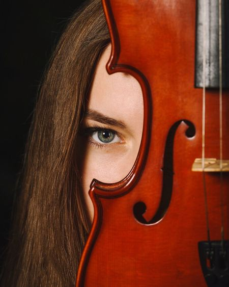 Close-Up Portrait Of A Young Woman With Violin