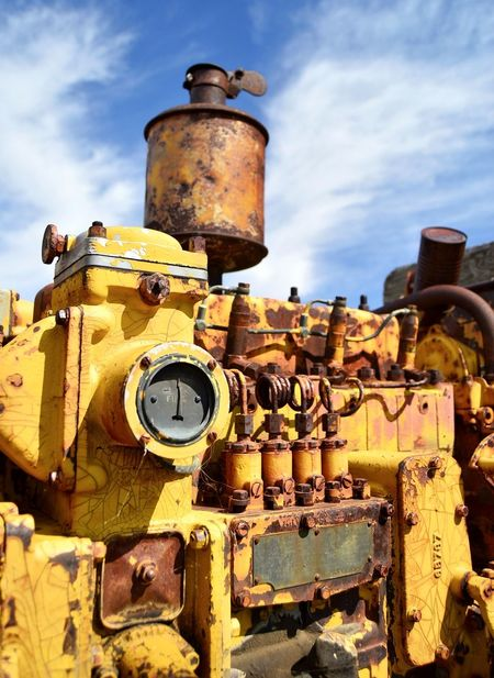 Motor North Of Douglas Wyoming Outdoors Clouds And Sky Yellow Color Sunshine Shadow Old Weathered Metal Rusted Abandoned Junkyard Bad Condition