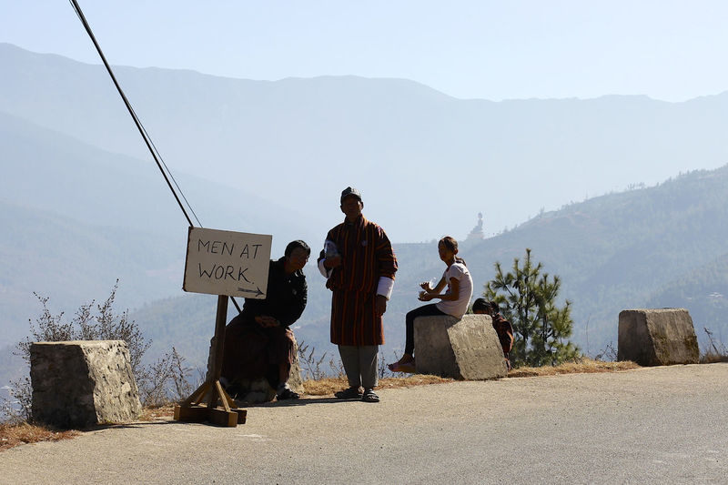 People on mountain road against sky