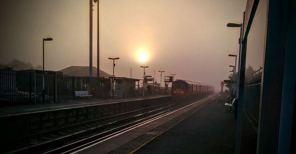 Rail Transportation Railroad Track Outdoors Railroad Station Platform Sunrise Morning Light Cold Temperature Transportation Ash