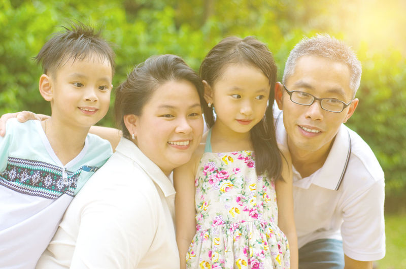 Close-up of happy family against plants