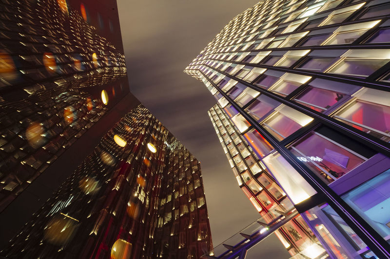 Low angle view of illuminated skyscraper against sky at night