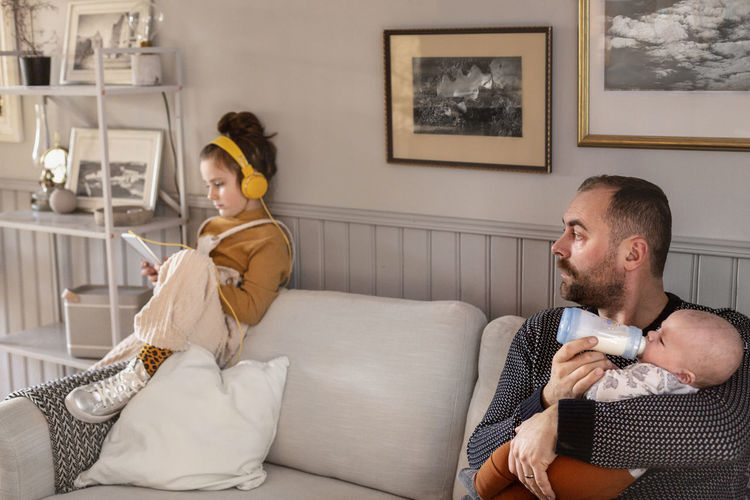 Young couple sitting on sofa at home
