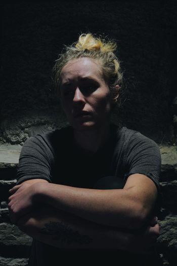Depressed woman sitting in basement