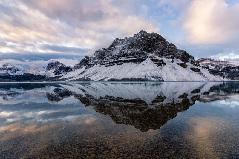 Sunrise in bow lake Sunrise Landscape Water Sky Cloud - Sky Beauty In Nature Cold Temperature Scenics - Nature Snow Tranquility Lake Nature No People Mountain Reflection Outdoors First Eyeem Photo