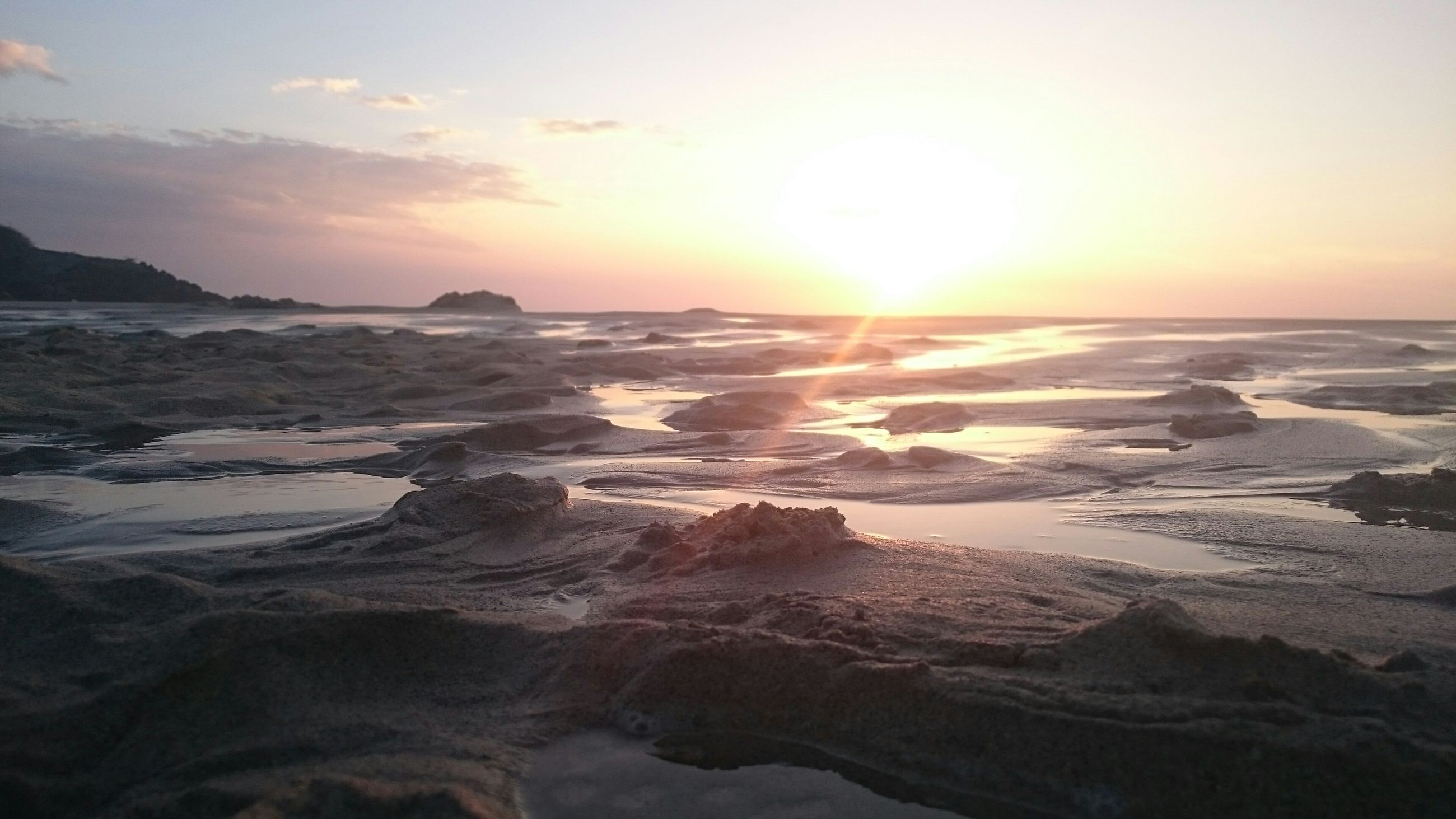 sunset, sea, scenics, water, tranquil scene, beauty in nature, tranquility, beach, sun, horizon over water, nature, sky, idyllic, orange color, shore, rock - object, sunlight, wave, reflection, remote