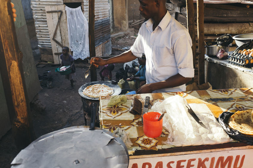Africa African Basic Cook  Cooking Fast Food Food Food And Drink Freshness Fried Hot Plate Mpigi Occupation Omlette Preparation  Real People Rolex Simple Food Street Food Street Food Stall Street Food Vendors Street Food Worldwide Street Foods Street Vendor Takeaway