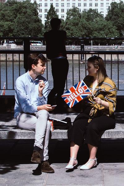 Hello? Street Photography Streetphotography LONDON❤ Street Photo London Malephotographerofthemonth Full Length Sitting Student Togetherness National Flag Patriotism The Street Photographer - 2018 EyeEm Awards