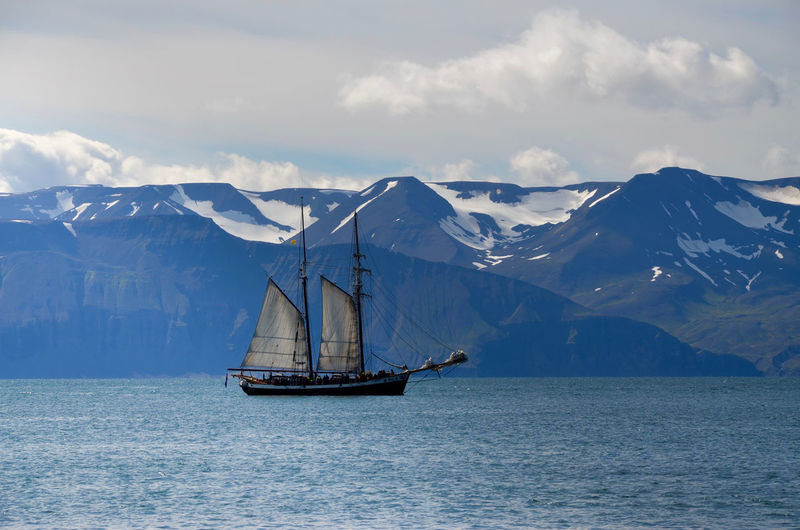 Whale watching sailing ship in Húsavik - Iceland Beauty In Nature Calm Husavik Iceland Mast Mountain Mountain Peak Mountain Range Nature Nautical Vessel Non-urban Scene Rocky Mountains Sailboat Sailing Sailing Ship Scenics Sea Ship Sky Tranquil Scene Tranquility Transportation Water Waterfront Whale Watching