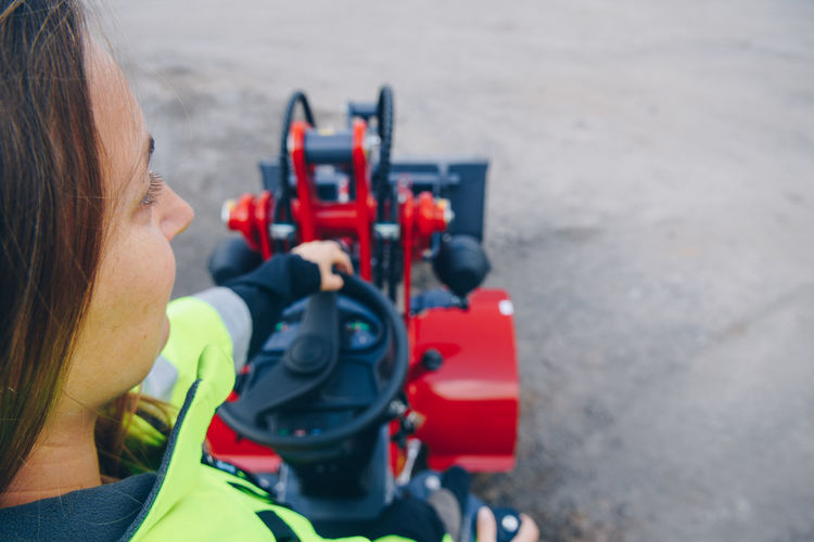 High Angle View Of Woman With Machinery At Construction Site
