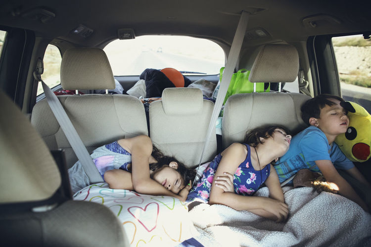 People sleeping in car