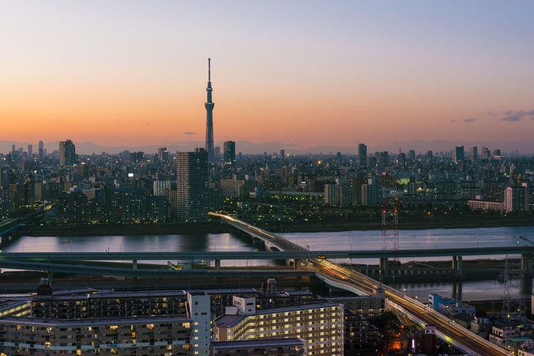 Tokyo skytree and asakusa district skyline during sunset.