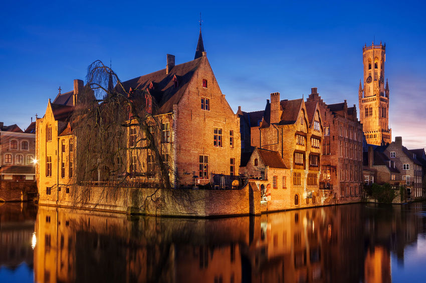 Bruges Architecture at Night - Bruges Bruges Brugge Belgium Canal Water Water Reflections Reflection Reflections In The Water Architecture Buildings Belfry Bell Tower Night Nightphotography Blue Hour Illuminated Cityscape Cityscape Photography City Urban Urban Landscape Urban Photography Travel Travel Destinations Flemish Architecture Tourism Tourist Destination