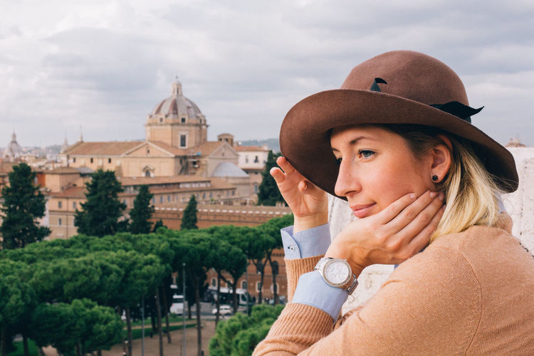 Travel In Style Adult Architecture Building Exterior Built Structure Clothing Day Hat Headshot Leisure Activity Lifestyles Looking Nature One Person Outdoors Portrait Real People Sky Young Adult Young Women