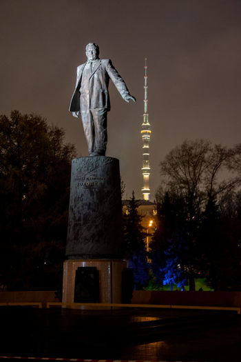 The monument to Korolev and Ostankino TV tower Architecture City Illuminated Korolëv No People Ostankinotvtower Sculpture Statue Tree TV Tower Vertical