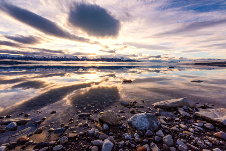 Lake Reflections Reflection Beach Beauty In Nature Cloud - Sky Idyllic Nature No People Outdoors Pebble Rock Scenics - Nature Sky Sunset Surface Level Tranquil Scene Tranquility Water