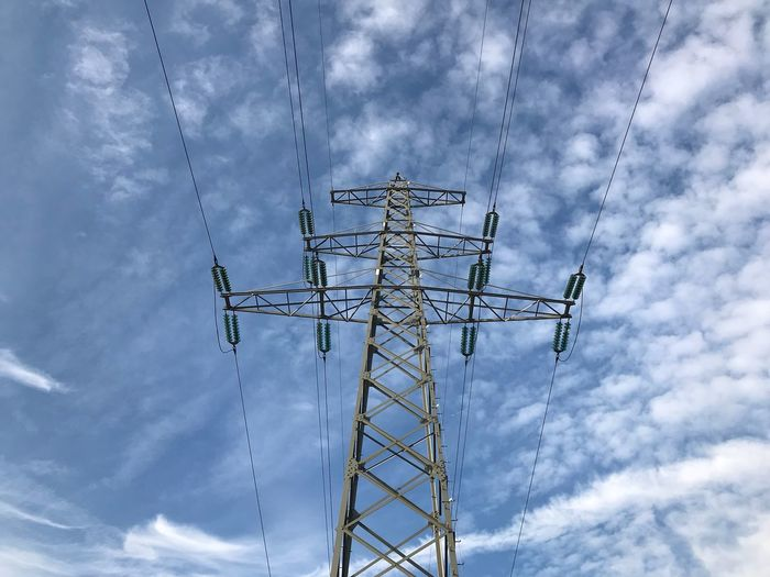 Electric Sky EyeEm Selects Cloud - Sky Sky Low Angle View Nature Connection No People Tall - High Day Metal Built Structure Outdoors Electricity Pylon Technology Electricity  Architecture Cable Power Line  Power Supply Blue