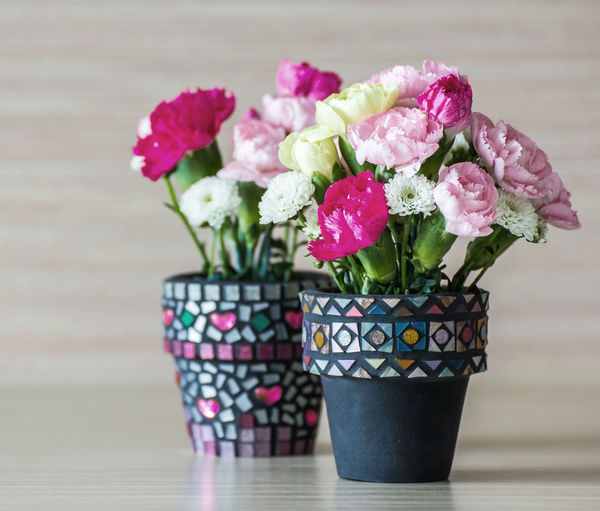 Close-up of pink flower pot on table