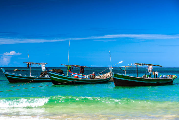 Bay Of Bengal Beach Beauty In Nature Blue Day Fisherboats  Horizon Over Water Indian Ocean Mode Of Transport Moored Nature Nautical Vessel in Ngapali Beach, Myanmar No People Outdoors Scenics Sea Sky Transportation Water Waterfront Sommergefühle
