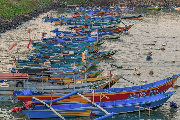 High angle view of fishing boats moored at beach