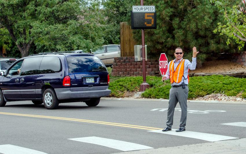 Full length of man standing on road