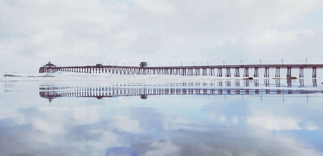 Text on bridge against sky