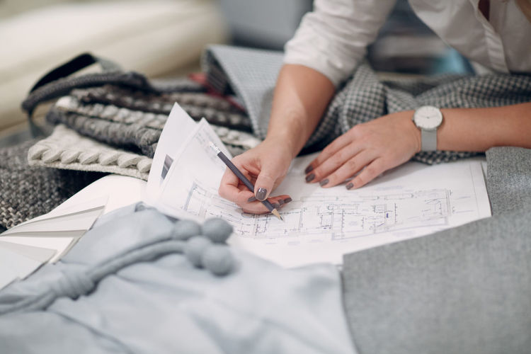 Midsection of woman working on fabric