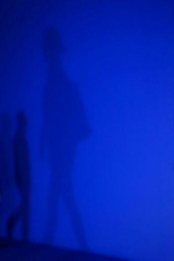 Shadow of man on blue light