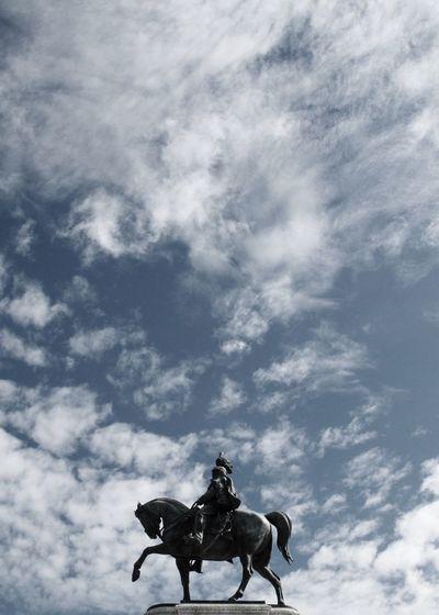 Low angle view of statue at altare della patria against sky