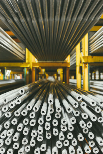 Close-up of steel pipes in factory
