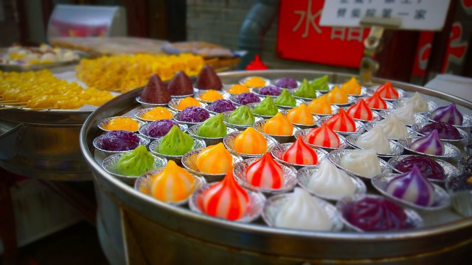 ShotOnMyLumia  Colorful China ASIA Chinese Chinese Food Xiaolongbao For Sale Food And Drink Food Freshness Retail  Food Stories In A Row No People Focus On Foreground Market Close-up Multi Colored Yellow An Eye For Travel An Eye For Travel Moments Of Happiness