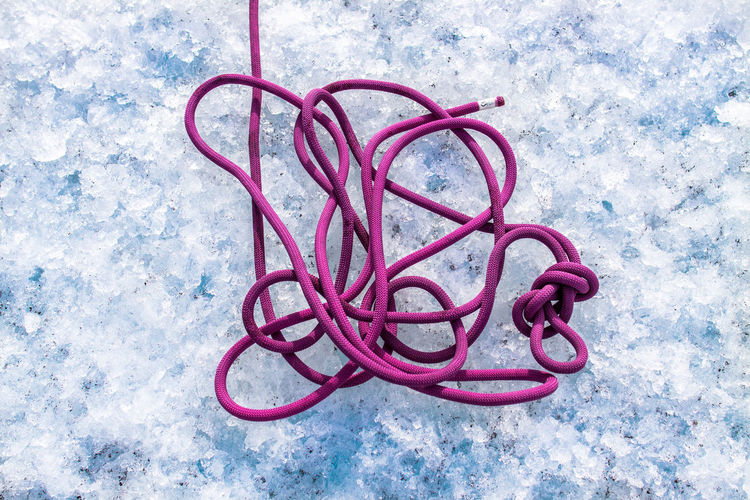 Directly Above Shot Of Pink Rope On Snow